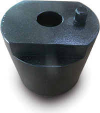 Black cylindrical object with hole in top