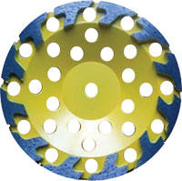 Yellow disk with dark, stylised t shaped grinders
